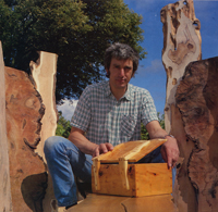 Peter Lloyd sitting with a box